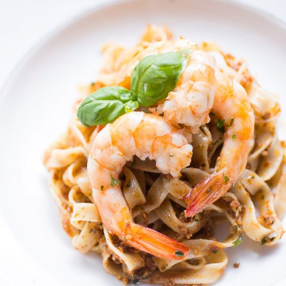Tagliatelle with red pesto and king prawns